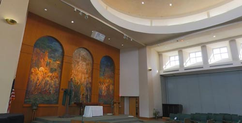 Light shining through windows of church